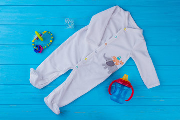 White soft wool baby pajama with toys.