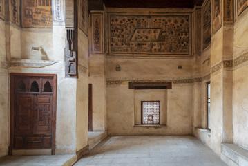 Stone wall with wooden window (Mashrabiya) at ottoman era historic Beit El Set Waseela building (Waseela Hanem House), Old Cairo, Egypt