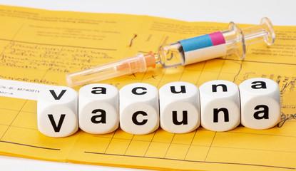 vacunar; vacuna escrito con dados