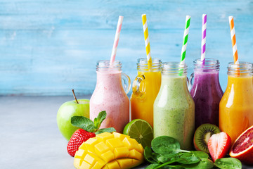 Summer colorful fruit smoothies in jars with ingredients. Healthy, detox and diet food concept. Wall mural