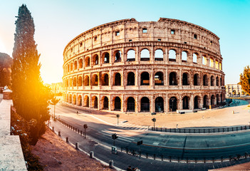Poster - The ancient Colosseum in Rome at sunset