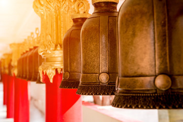 Symbols of Buddhism. Bells. South-Eastern Asia. Details of buddhist temple in Thailand.