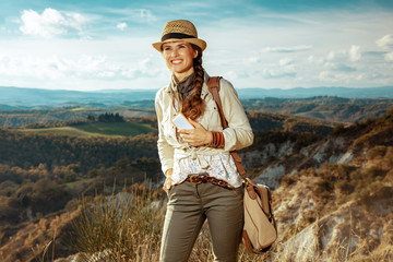happy traveller woman on summer Tuscany trekking writing sms