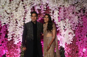 Akash Ambani, son of Mukesh Ambani, Chairman of Reliance Industries, and his wife Shloka Mehta pose during a photo opportunity at their wedding reception in Mumbai
