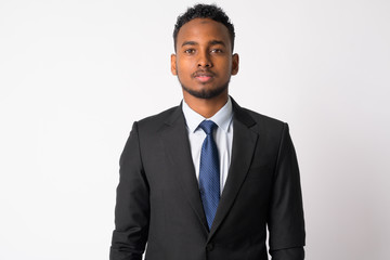Portrait of young handsome African businessman in suit