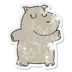 distressed sticker of a cartoon hippo