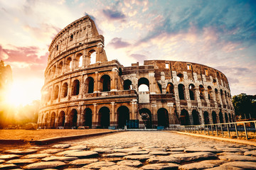Foto auf AluDibond Altes Gebaude The ancient Colosseum in Rome at sunset