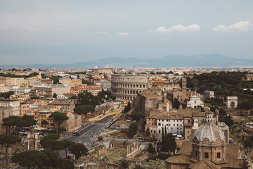 Panoramic view of city Rome with Roman forum and Colosseum from Vittoriano