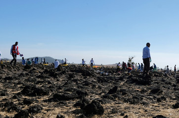 Rescue workers are seen at the scene of the Ethiopian Airlines Flight ET 302 plane crash, near the town of Bishoftu