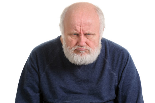 grumpy oldfart or dissatisfied displeased old man isolated portrait