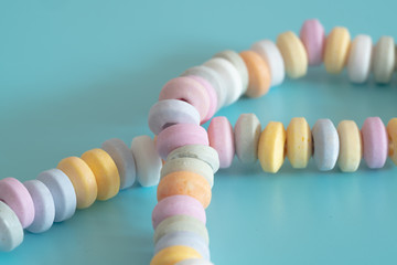 Beads and bracelets of sweets  candy on a turquoise background