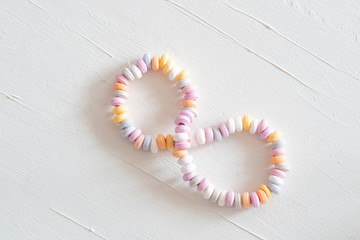 Beads and bracelets of sweets  candy on a white background