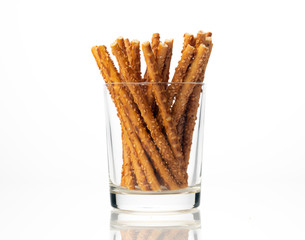 Sesame sticks on a white background
