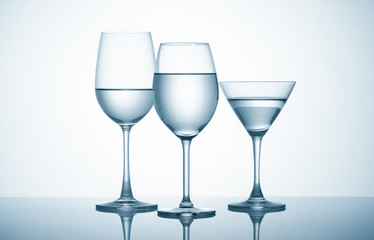 Glasses with water on blue background