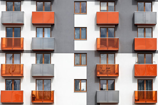 Facade of a colorful and modern multi-family building as a full frame background