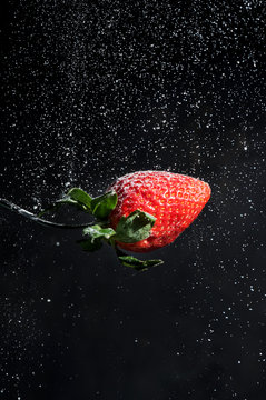 Sugar pouring over strawberry