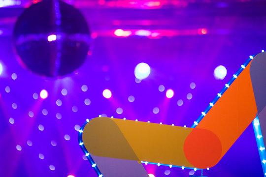 scenery of a disco. disco ball light fixtures. concert. scene
