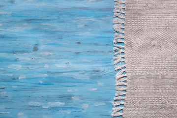 Rustic tablecloth from right side of blue wooden table top view with copy space