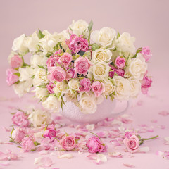 Close-up floral composition with a pink roses .Many beautiful fresh pink roses on a table.Pastel colors.