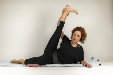Portrait of woman doing workout exercises and training. Yoga.