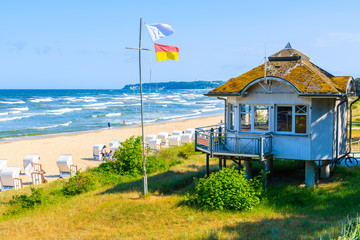 Fototapete - Lifeguard booth on beach in Goehren summer resort among sand dunes, Ruegen island, Baltic Sea, Germany