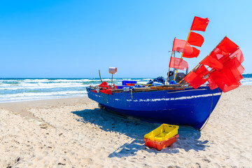 Fishing boat on sandy beach in Baabe village, Ruegen island, Baltic Sea, Germany.