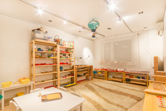 Spacious light  classroom  in the kindergarten. Table for classes on foreground
