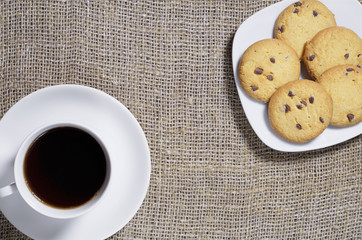 Coffee and cookies on burlap