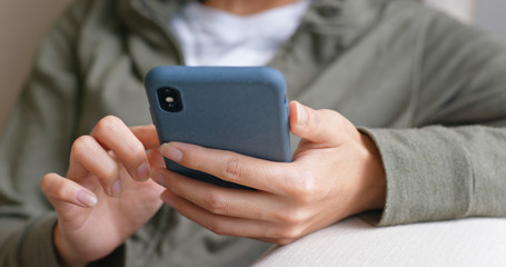 Close up of woman touch on smart phone