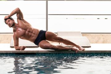Young Looking Macho Man At Hotel Indoor Pool