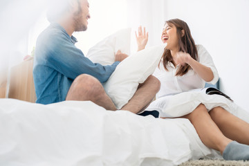 sweet asian couple happiness and joyful together on bed home family concept