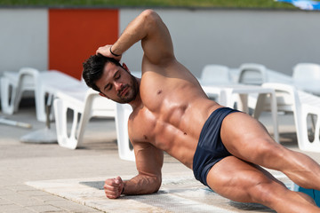 Portrait Of A Muscular Man At Swimming Pool