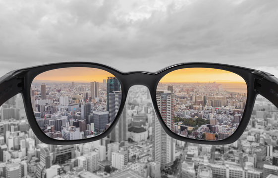 Looking through glasses to city view in sunset. Color blindness glasses, Smart glass technology