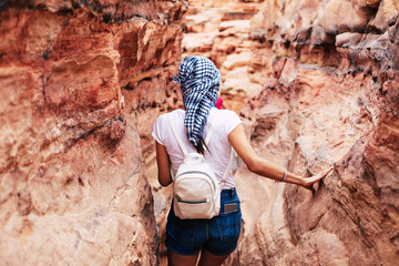 Back photo of tourist Woman during hiking in mountain