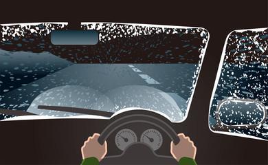 吹雪の天候でヘッドライトをロービームにして運転
