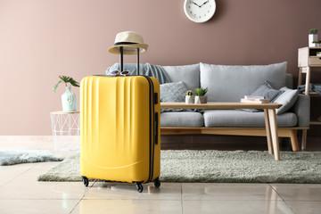 Fototapeta Packed suitcase in room. Travel concept obraz