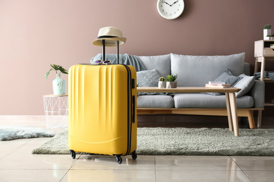 Packed suitcase in room. Travel concept