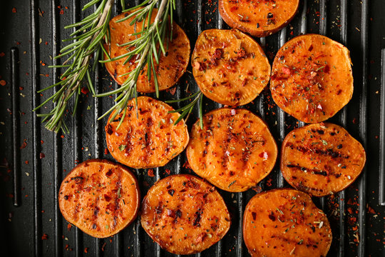 Tasty grilled sweet potato on pan