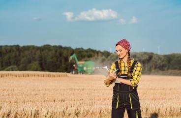 Farmer woman monitoring business progress of the harvest