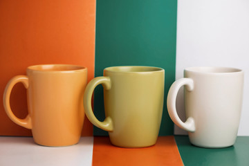 multi-colored ceramic cup on a colorful background