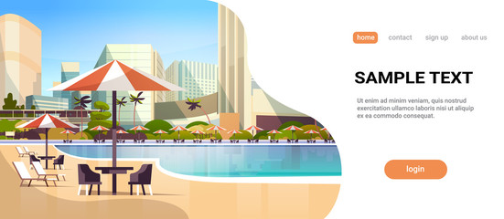 Fototapeta luxury city hotel swimming pool resort with umbrellas desks and chairs restaurant furniture around summer vacation concept beautiful landscape horizontal copy space