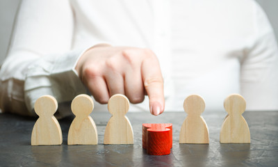 Woman leader dismisses the employee from the team. Female hand pushes a red man. Personnel Management. Bad worker. Demotion. Weak link. Team Management concept. Resignation. Businesswoman