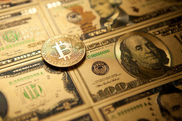 Bitcoin golden coin cryptocurrency on golden US dollar.
