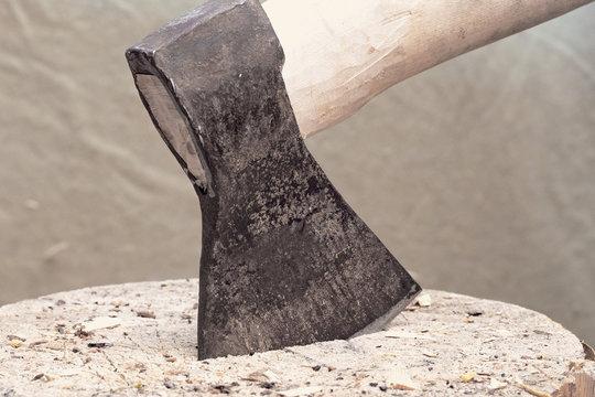 steel axe and wooden axe, axe stuck in wooden stump