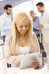 Happy woman with tablet pc