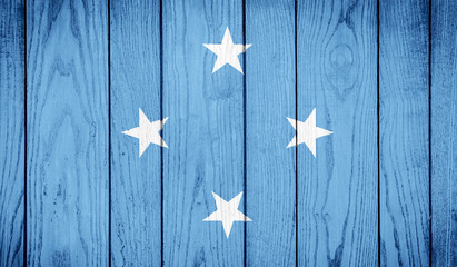 Flag of Micronesia on wooden background
