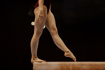 side view balance beam legs female gymnast competition in gymnastics