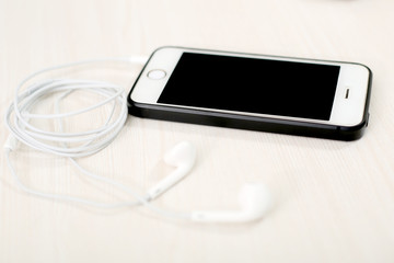 Picture of phone and earphone.