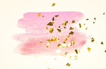 Abstract pink watercolor splash and golden glitter, pieces of foil, background in vintage nostalgic colors.