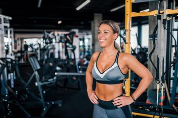 Beautiful sportswoman in the gym.